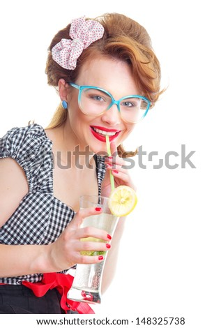 Young happy girl drinking juice, isolated on white - stock photo
