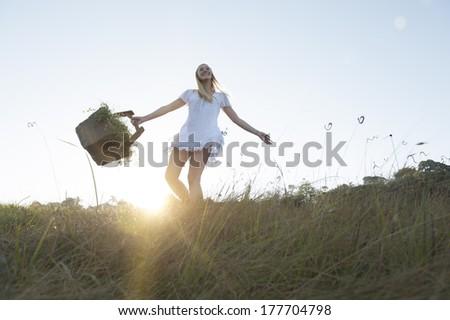 young happy girl enjoying morning sunshine - stock photo