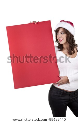 Young happy girl in Christmas hat holding a red board