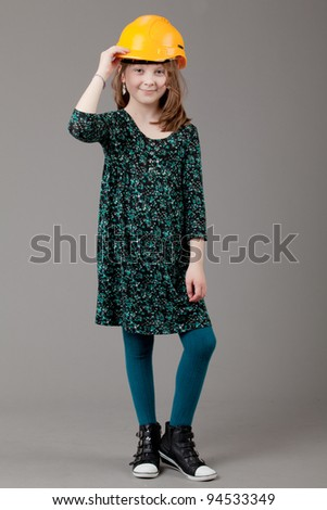 young happy girl.  little girl on a gray background. Picture of a funny little girl. - stock photo