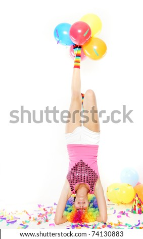 young happy girl standing on her head over white - stock photo