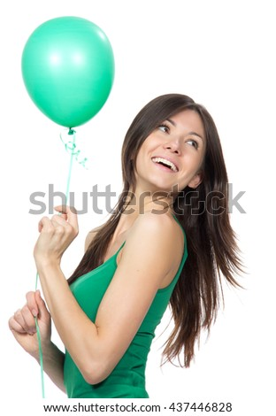 Young happy girl with green balloon as a present for birthday party smiling laughing isolated on a white background