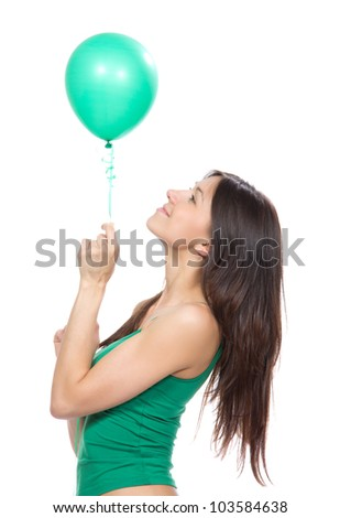 Young happy girl with green balloon for birthday party smiling  on a white background - stock photo