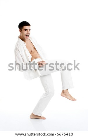 young happy handsome man in motion, studio shot - stock photo