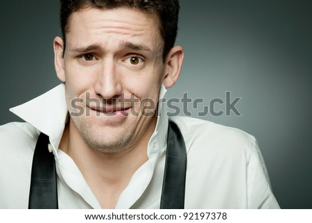 Young happy handsome man in white shirt. - stock photo