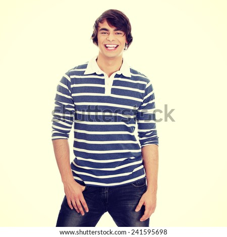 Young happy handsome man smiling - stock photo