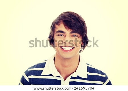 Young happy handsome man smiling. - stock photo