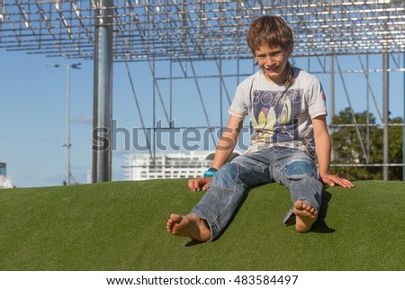 young happy kid having fun outdoors, auckland, new zealand