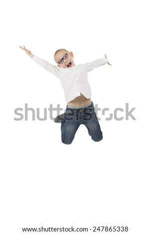 Young happy kid jumping in the air against a white background, soft focus - stock photo