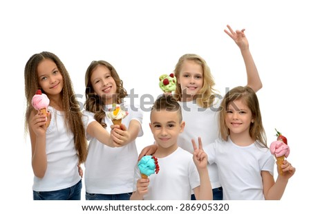 Young happy kids girls and boy ready eating red green blue raspberry vanilla ice cream in waffles cones smiling yelling isolated on a white background - stock photo
