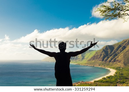 Young happy male backpacker celebrating natures beauty. (Location Hawaii) - stock photo