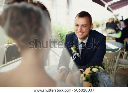 young happy man admires his bride
