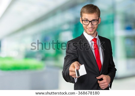Young happy  man holding credit card - stock photo