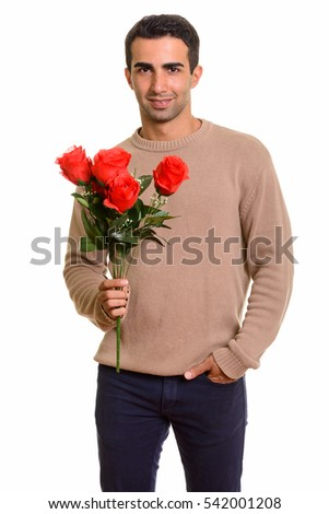 Young happy man holding red roses ready for Valentine's day isolated against white background