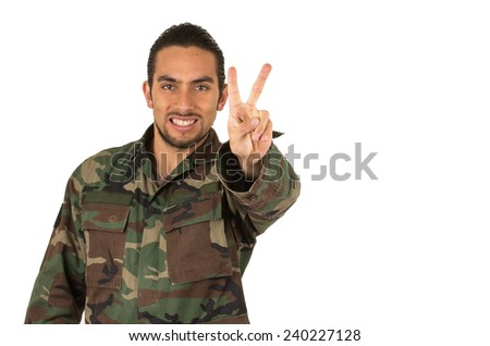 young happy man in military uniform gesturing peace sign isolated on white - stock photo