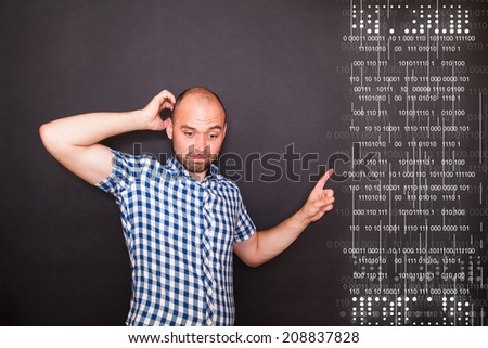Young happy man pointing  his finger to the diagram - stock photo
