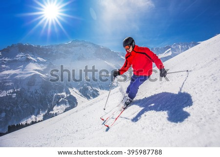 Young happy man skiing in Lenzerheide ski resort, Switzerland.