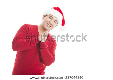 Young happy man smile with Christmas hat and red sweater isolated on white. - stock photo