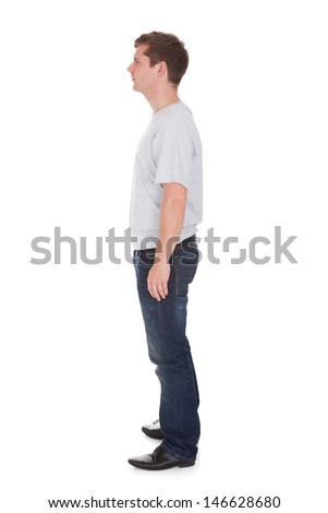 Young Happy Man Standing Over White Background - stock photo