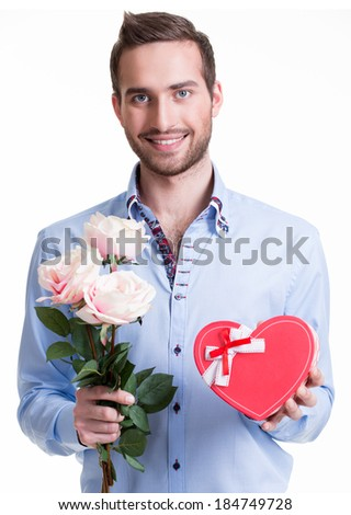 Young happy man with a pink roses and a gift - isolated on white. - stock photo
