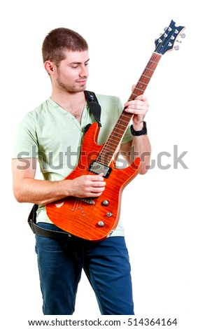 Young happy man with guitar. Isolated un white