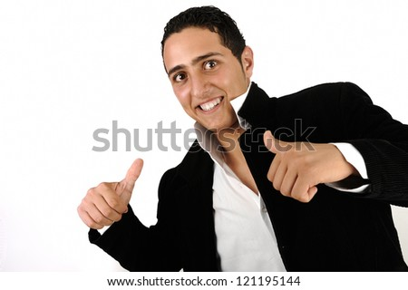Young happy man with his thumbs up - stock photo
