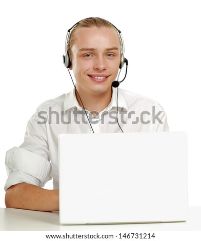 Young happy man with laptop sitting on the desk , isolated on white background