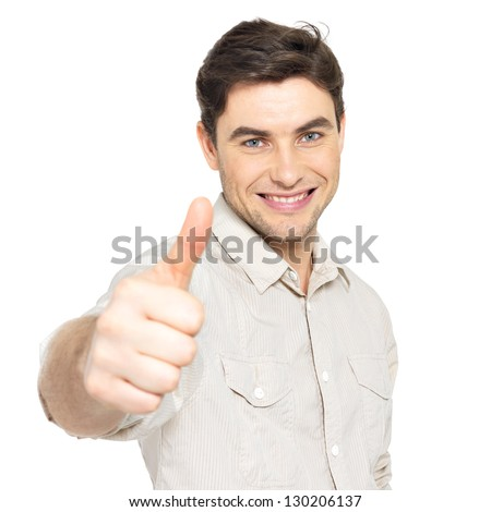 Young happy man with thumbs up sign in  casuals isolated on white background.