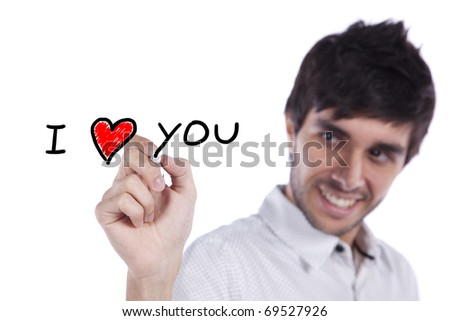 Young happy man writing a love message on the whiteboard (selective focus) - stock photo
