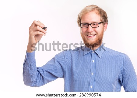 Young happy man writing on transparent board - studio shoot  - stock photo