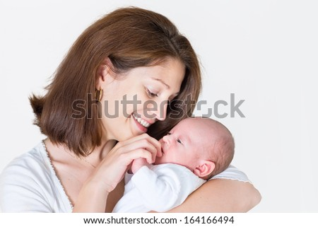 Young happy mother holding her newborn baby - stock photo