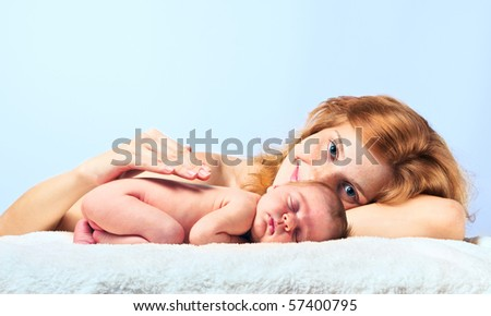 Young happy mother with newborn baby - stock photo