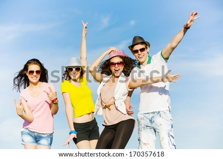 Young happy people having fun outside in summer - stock photo