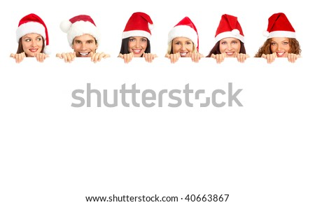 Young happy people in Christmas hats. Isolated over white background - stock photo