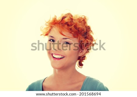 Young happy red head woman.