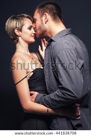 Young happy romantic couple in love kissing and hugging. Sexy pose.