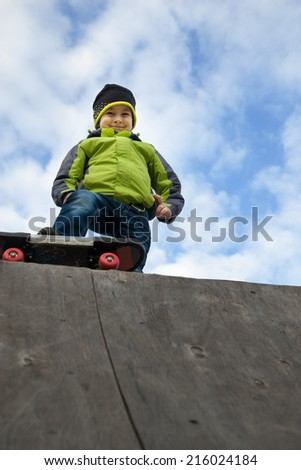 Young happy skater training on the table - stock photo