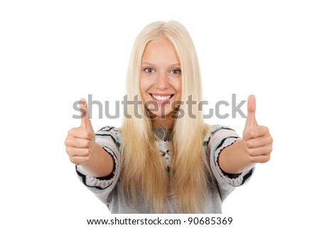 young happy smile teenage girl holding two hands with thumb up gesture, wear winter knitted sweater, isolated over white background - stock photo