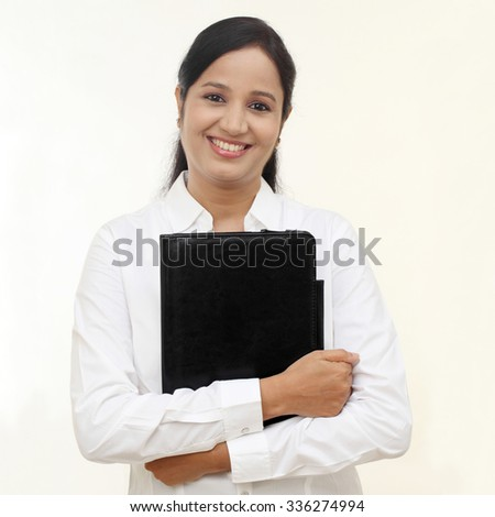 young happy smiling business woman with black folder