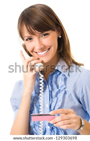 Young happy smiling business woman with plastic card, on cellphone, isolated on white background - stock photo