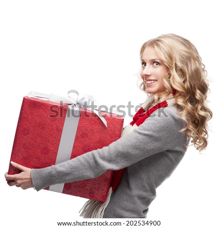 young happy smiling casual  blond woman holding red christmas gift isolated on white - stock photo