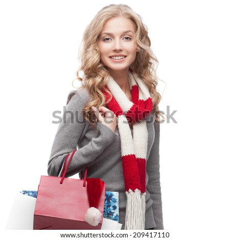 young happy smiling casual  blond woman holding  shopping bags isolated on white - stock photo