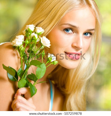 Young happy smiling cheerful woman with bouquet of white roses - stock photo