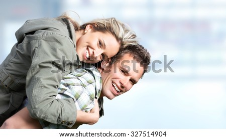 Young happy smiling couple over blue background