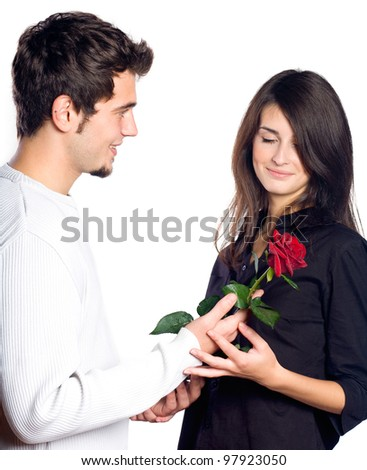 Young happy smiling couple with rose, isolated over white background - stock photo