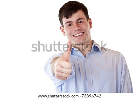 Young happy smiling handsome man shows thumb up. Isolated on white background.