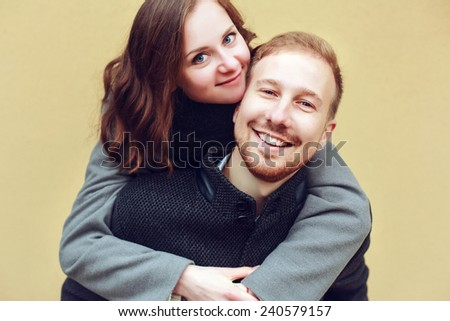 Young happy smiling hipster fashion couple in love have fun outdoor in cold autumn winter weather