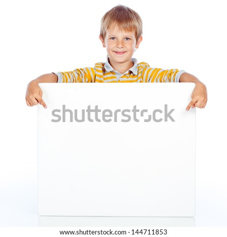 young happy smiling little boy look outs from the blank billboard. Fill-length portrait. Isolated on white