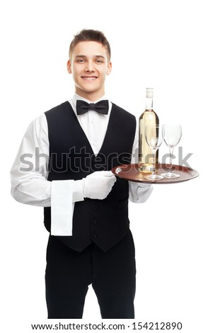 young happy smiling waiter with bottle of white wine and stemware glass on tray isolated on white background