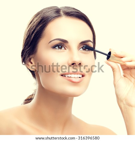 Young happy smiling woman with cosmetics brush - stock photo